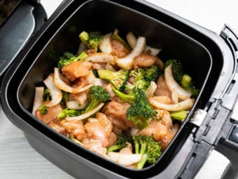 Chicken and broccoli in air fryer basket