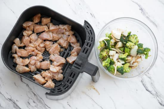 Chicken in air fryer, broccoli and onion on the side