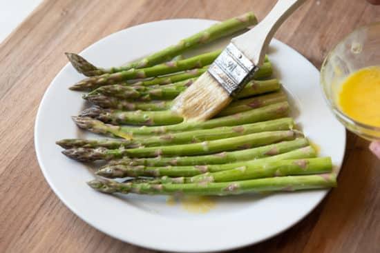 Brushing Asparagus with beaten egg