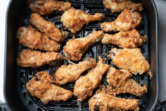 Air fried chicken wings in basket