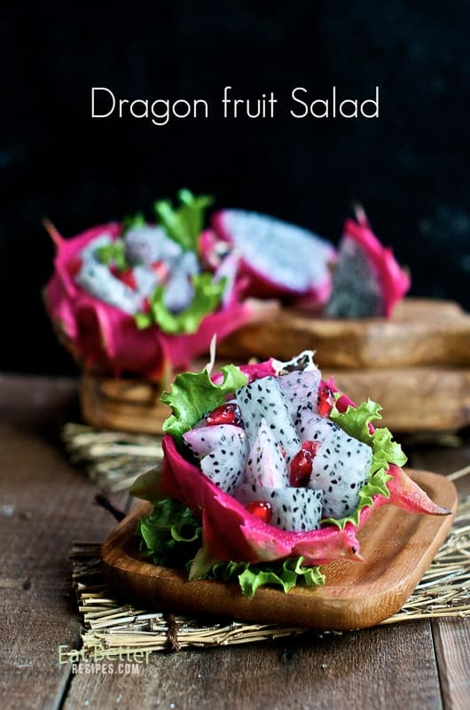 Fresh Dragon fruit cut open on a cutting board