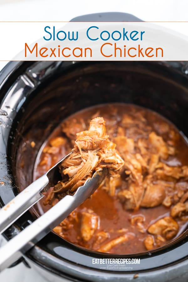 Slow Cooker Mexican Chicken in a slow cooker with a tong